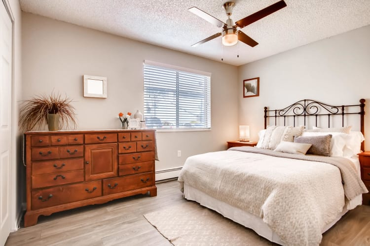Spacious master bedroom with a ceiling fan at Mountain Vista in Lakewood, Colorado