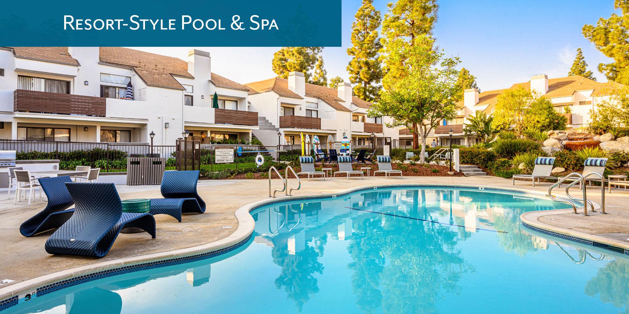 Resort-style swimming pool and spa at Sendero Huntington Beach in Huntington Beach, California