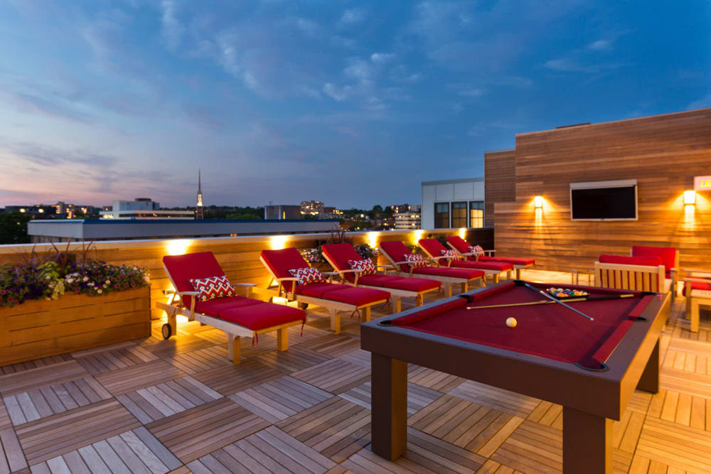 Enjoy a renovated private balcony with pool table at The Verano in Stamford, Connecticut