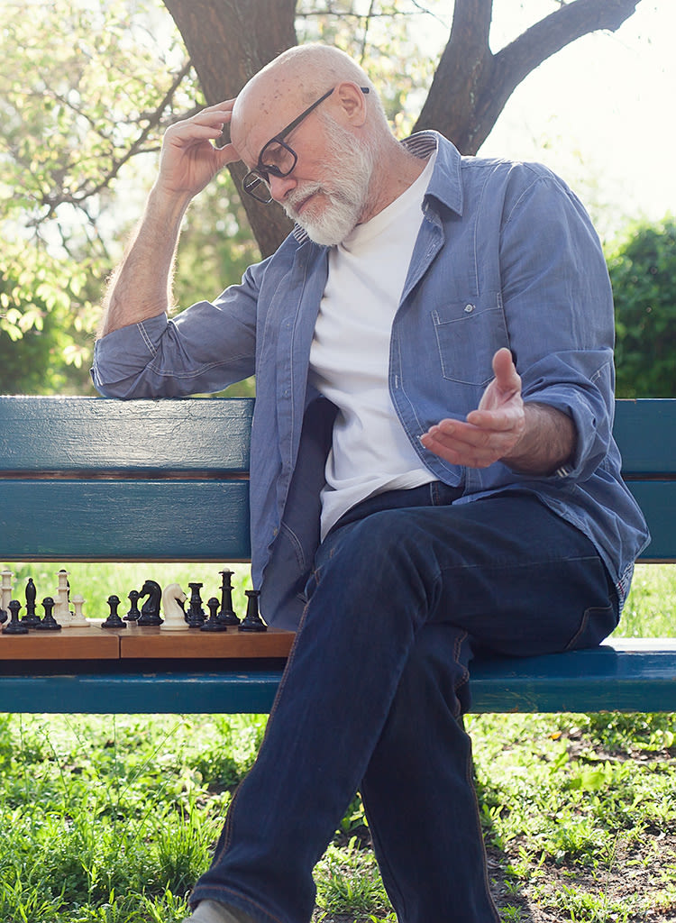 Senior playing chess in the park at Welbrook Arlington in Riverside, California