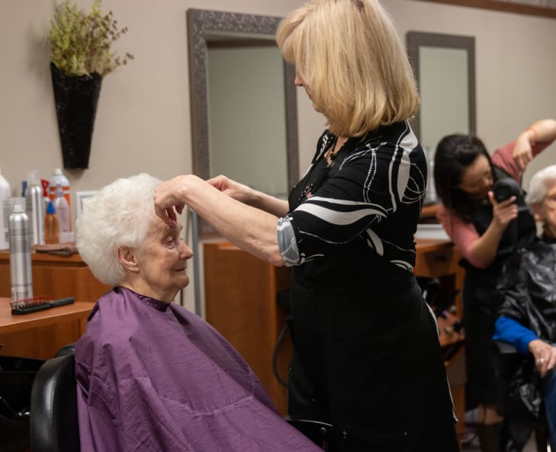 A resident getting her hair cut at Aurora on France in Edina, Minnesota.