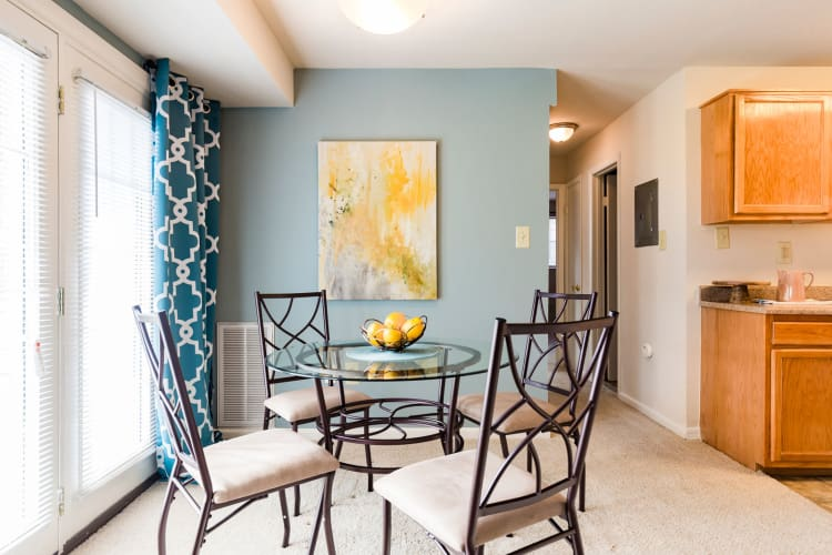 Dining nook next to french doors that open to private patio in model home at Westgate Apartments & Townhomes in Manassas, Virginia