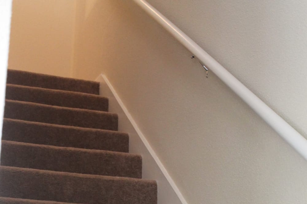 Stairs inside apartments at The Abbey at Montgomery Park apartments in Conroe