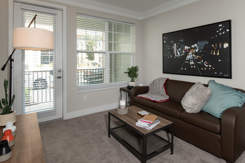 Modern living rooms with brown couch at Quantum on West Call