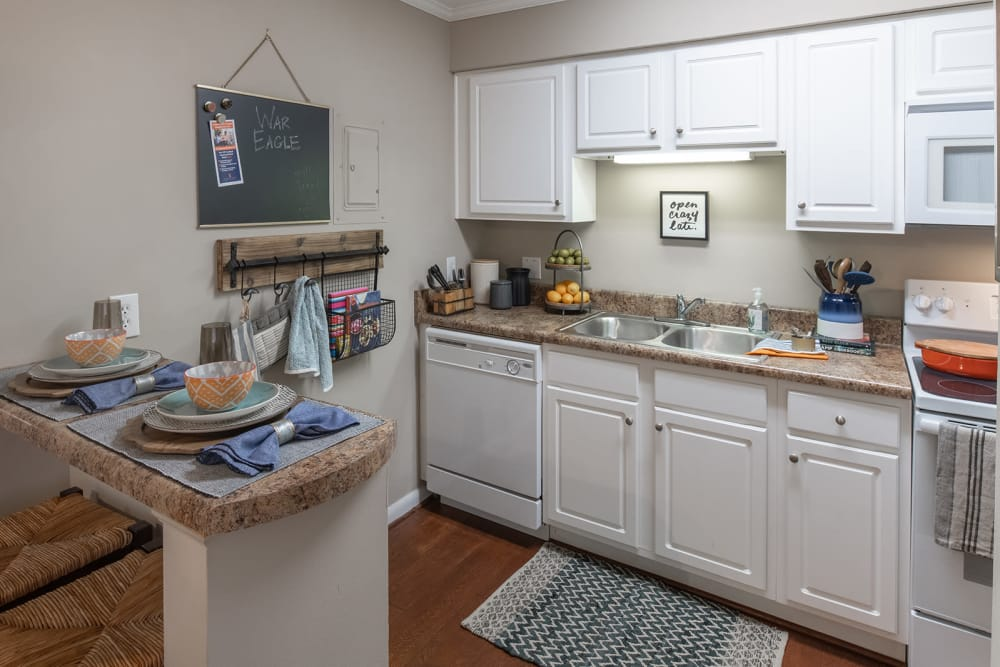 Kitchen breakfast bar at Eagles West Apartments in Auburn