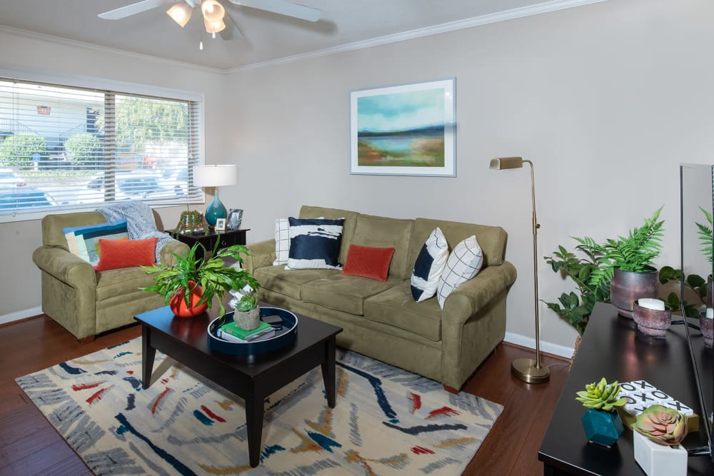 Living room in apartment at Eagles West Apartments in Auburn