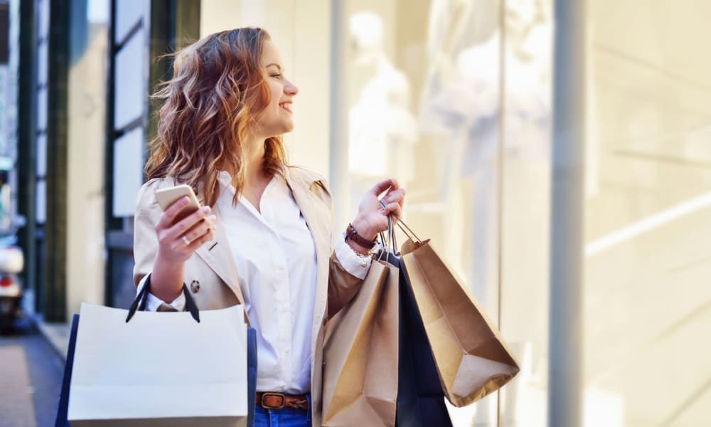Resident getting some retail therapy at the downtown boutiques near Mediterranean Village Apartments in Costa Mesa, California