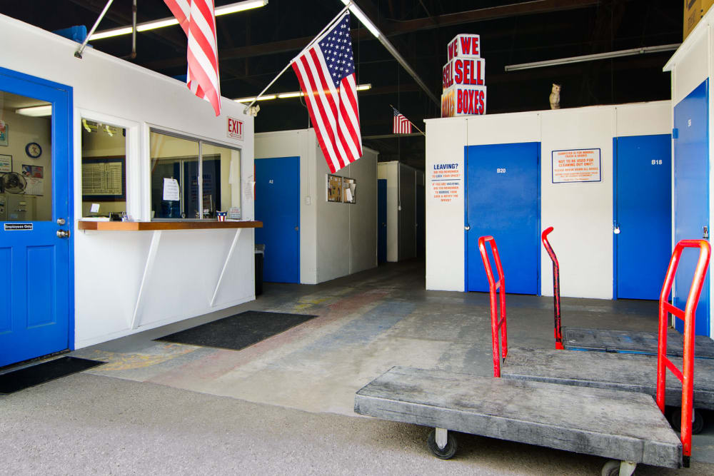 Office entrance with carts and boxes available at A-American Self Storage in Santa Barbara, California