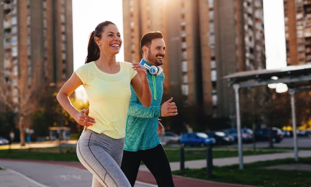 Resident couple going for a morning jog through the downtown neighborhood near Oaks Union Depot in St. Paul, Minnesota