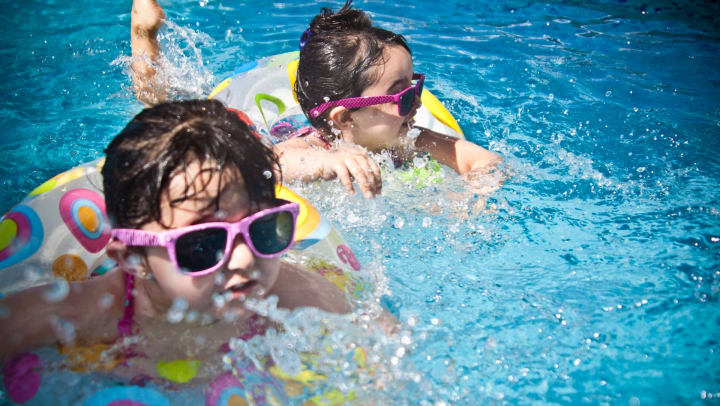 Children enjoying a day in the sun at a water park near Olympus Sierra Pines in The Woodlands, Texas