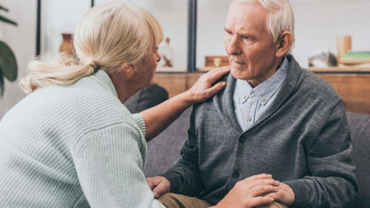 Senior man with dementia with adult daughter caregiver