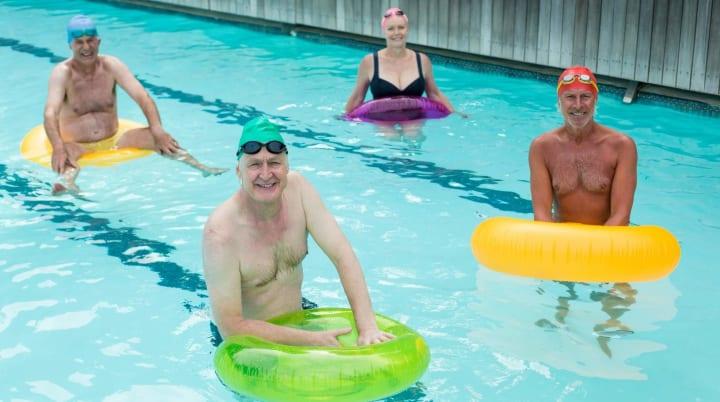 Seniors doing water aerobics together