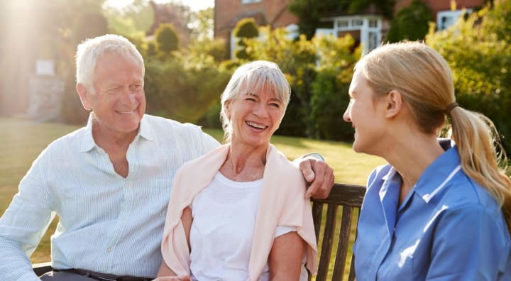 Senior couple smiling with nurse
