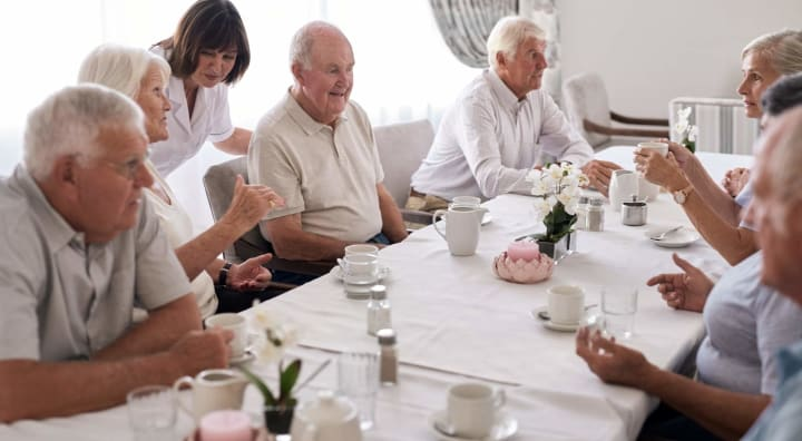 Group of seniors at dining room table