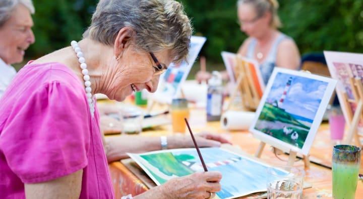 Seniors painting outside