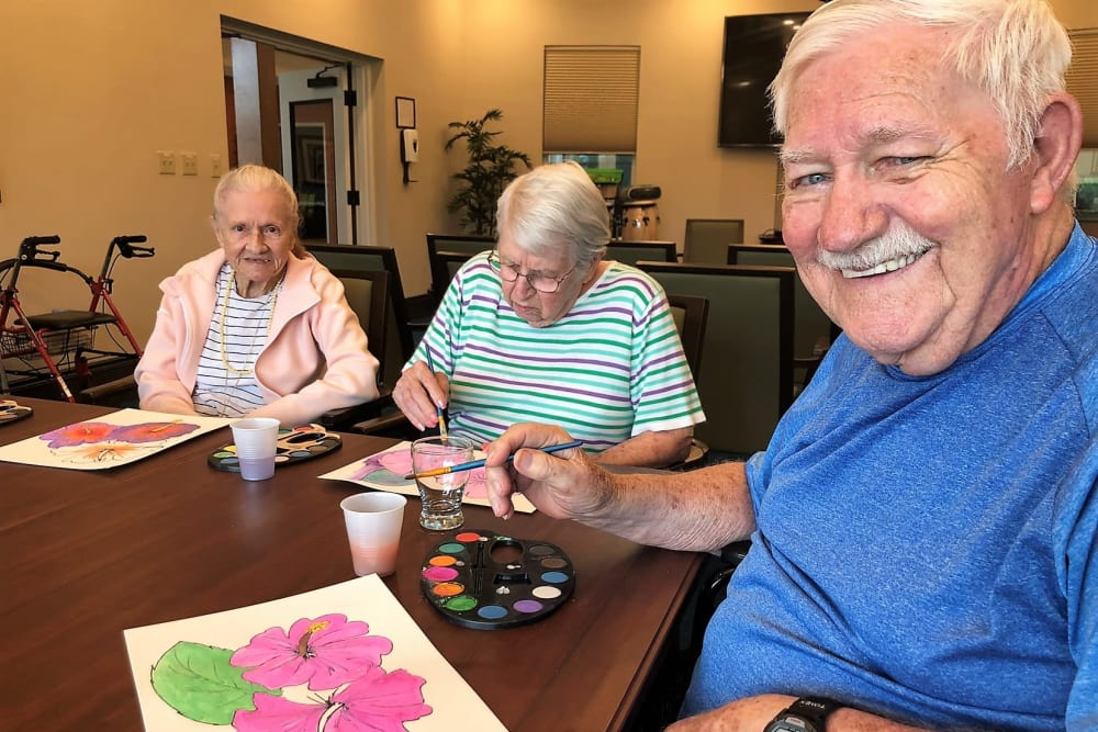 senior residents enjoying painting