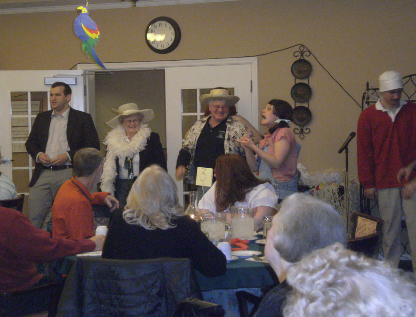 Residents playing a murder mystery game at Heritage Green Assisted Living and Memory Care in Lynchburg, Virginia