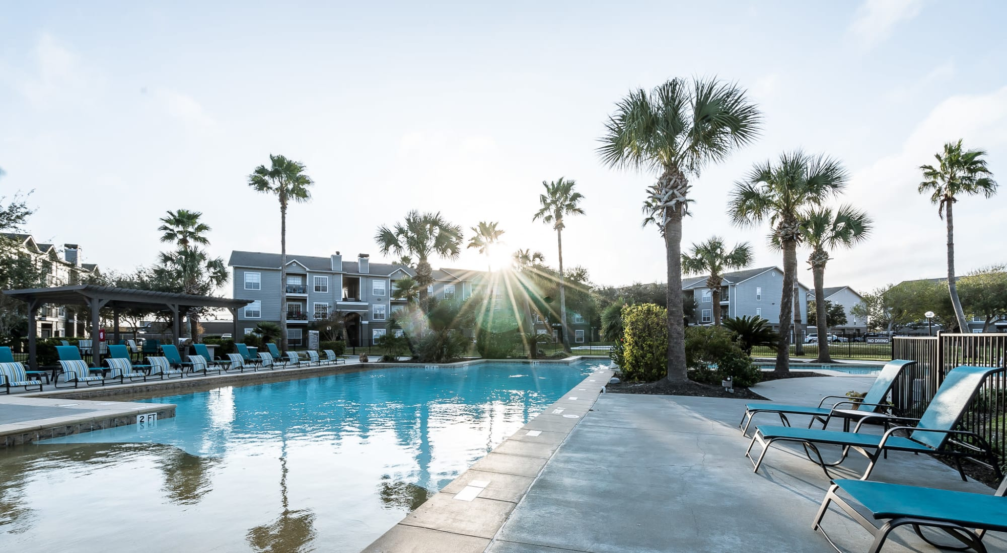 Swimming pool area on a beautiful morning at Azure Apartments in Corpus Christi, Texas