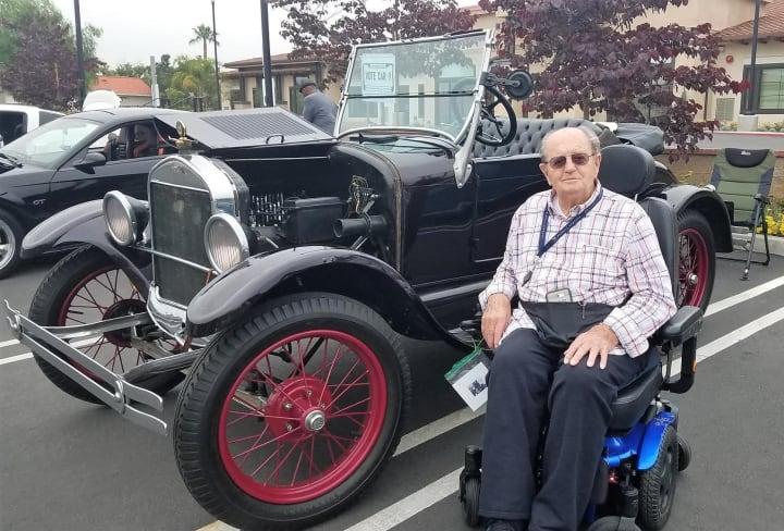 Resident next to classic car at Merrill Gardens at Rancho Cuamonga