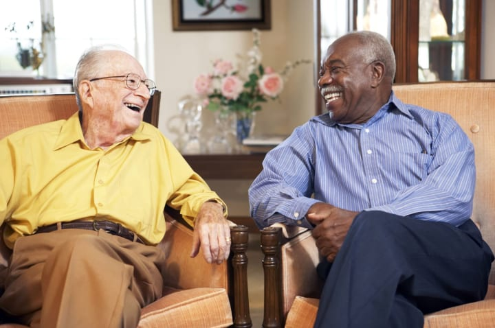 Two senior gentleman laughing together