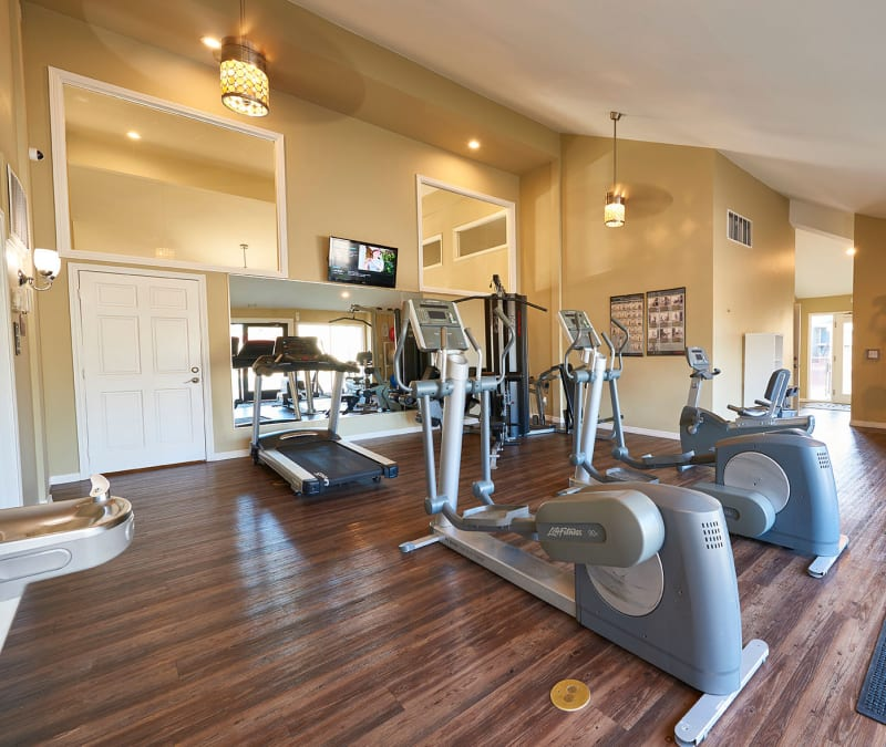 Fitness center with weights at Hampden Heights Apartments in Denver, Colorado