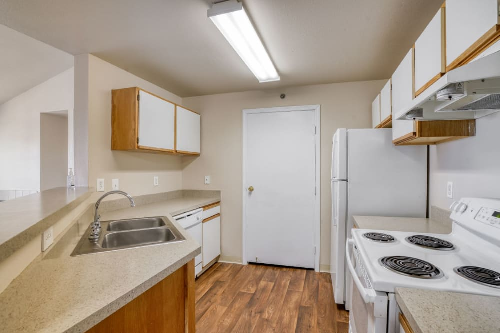 non-upgraded kitchen at The Pines at Castle Rock Apartments in Castle Rock, Colorado