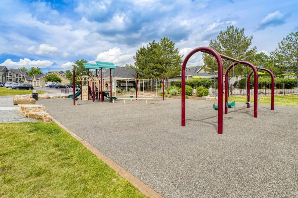 Playground & swing set at The Pines at Castle Rock Apartments in Castle Rock, Colorado