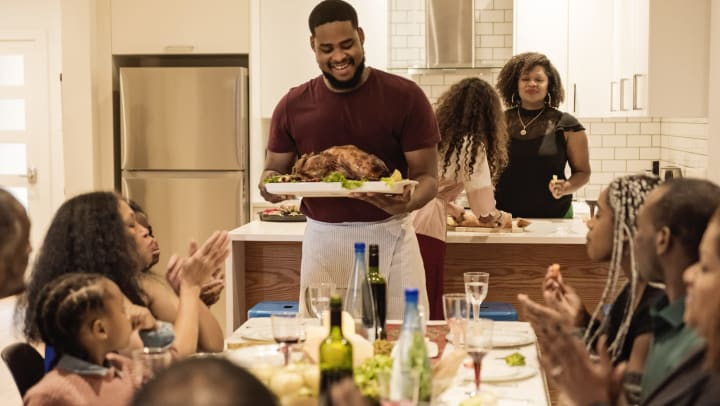 Multi-generation family enjoying Thanksgiving dinner at The Ranch at Shadow Lake