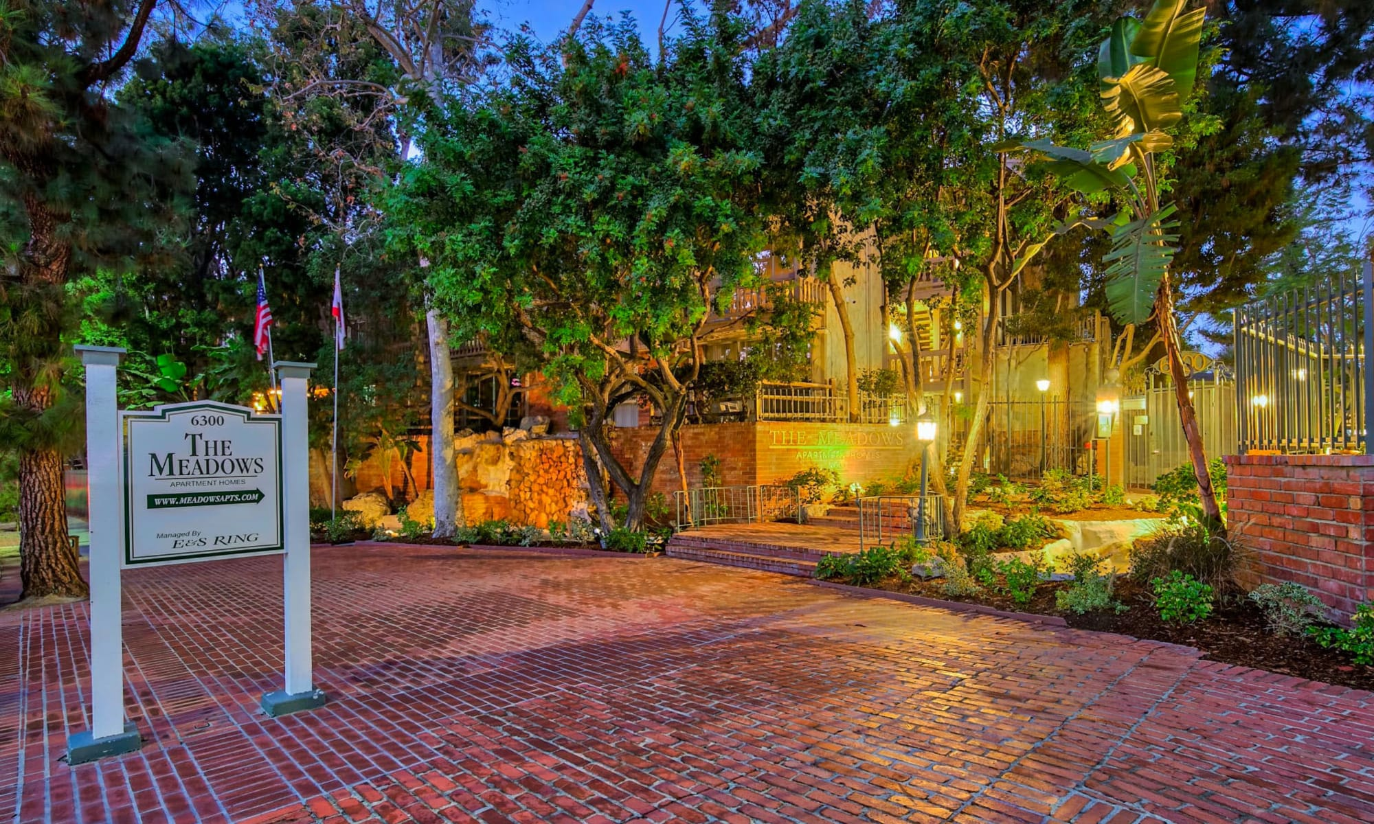 Beautiful well-lit brick walkway at dusk at The Meadows in Culver City, California