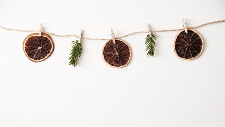 Homemade Christmas garland with dried fruits and pine