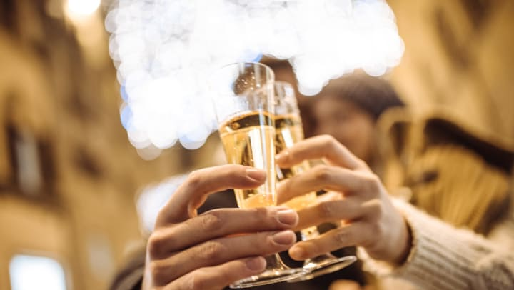 People cheering their champagne together