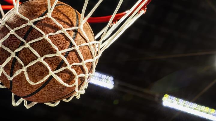 Basketball going through a basketball net