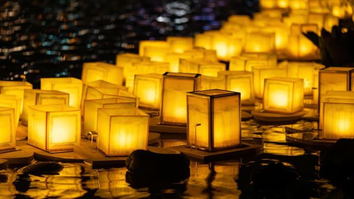 Floating lanterns on river
