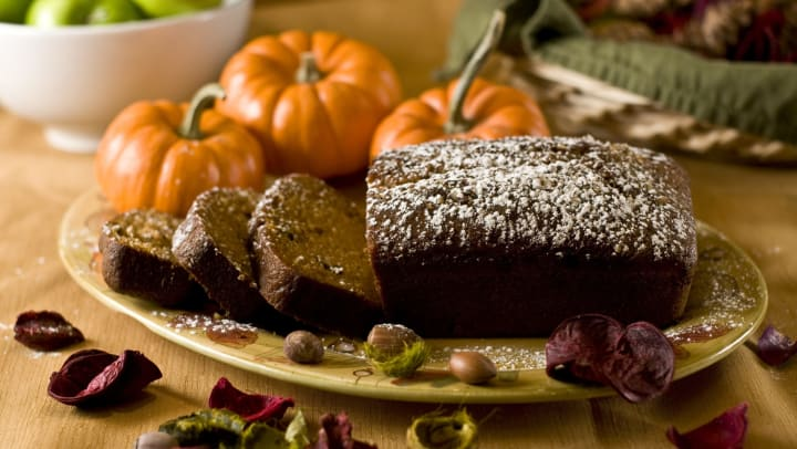 Delicious fresh pumpkin bread topped with powdered sugar surrounded by mini pumpkins at The Davis