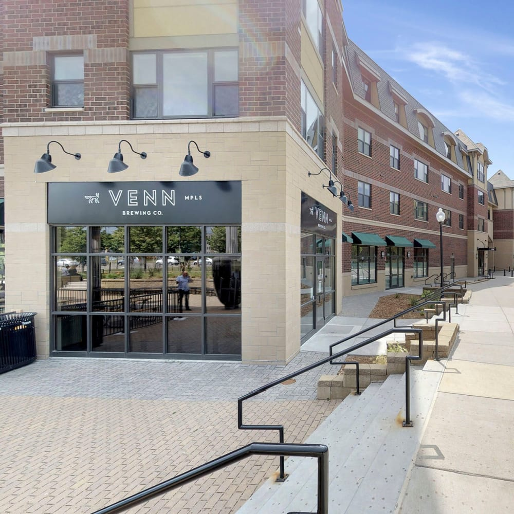 Venn Brewing and other retailers on street level at Oaks Station Place in Minneapolis, Minnesota