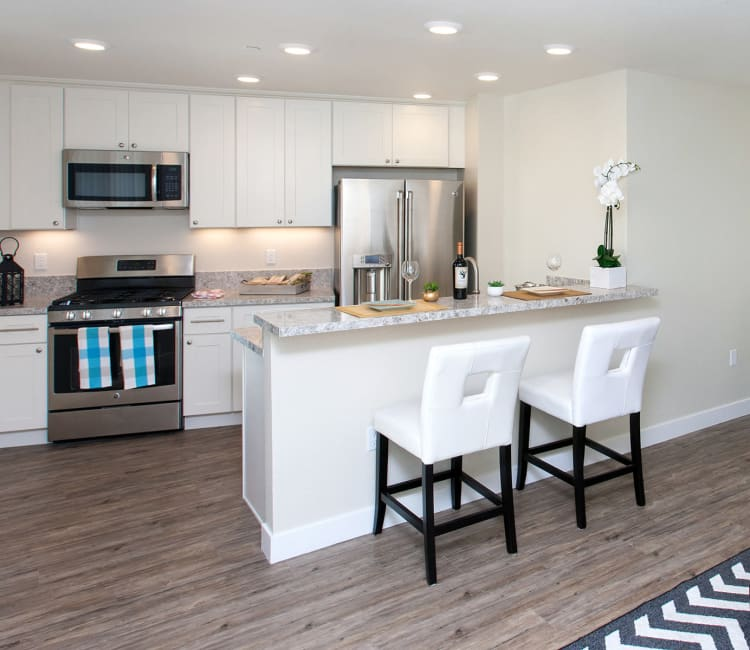 Hardwood floors in open-concept floor plan of model home at The Arlington in Burlingame, CA