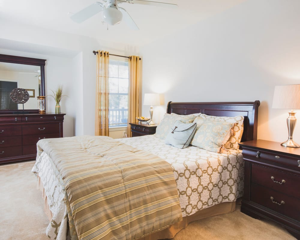 Spacious master bedroom with plush carpeting at Glade Creek Apartments in Roanoke, Virginia