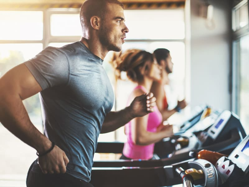 Residents staying in shape in the fitness center at Sentio in Phoenix, Arizona