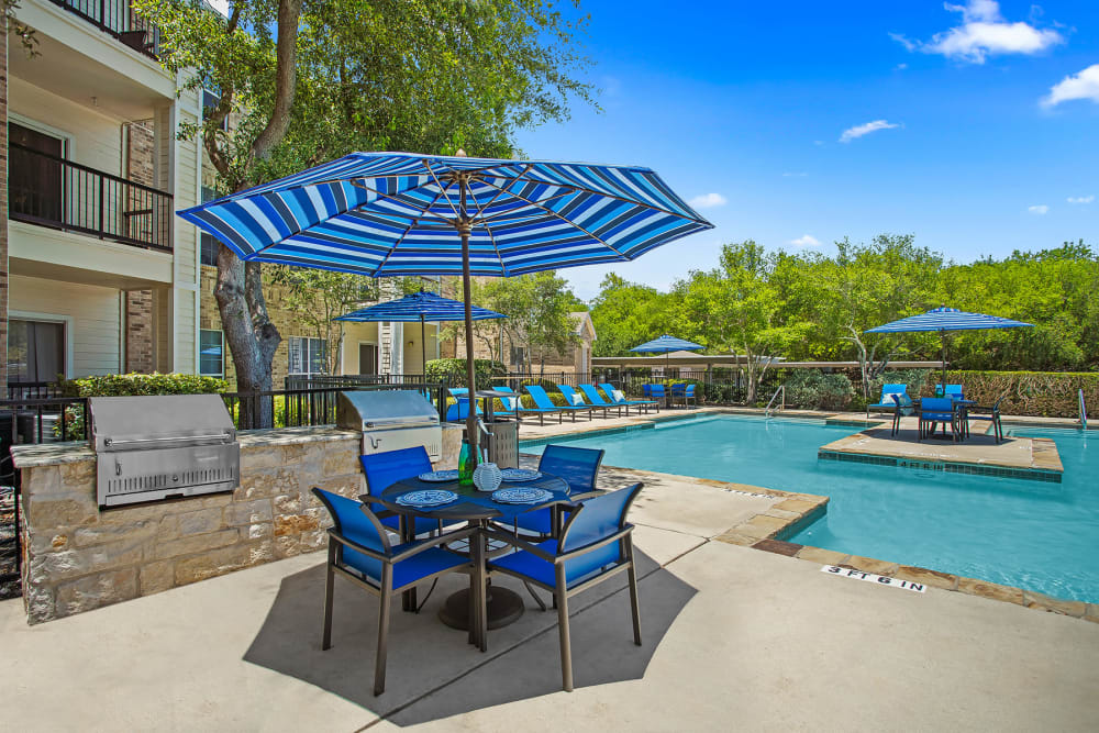 Outdoor BBQ Area & Swimming Pool at Stoneybrook Apartments & Townhomes in San Antonio, Texas