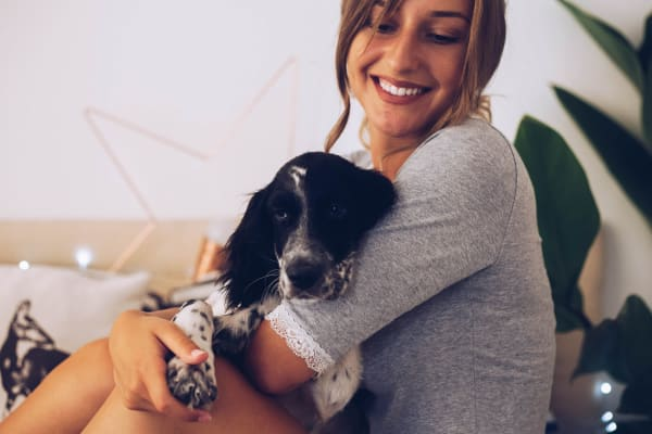 Resident giving her dog some love in their new home at Sentio in Phoenix Arizona