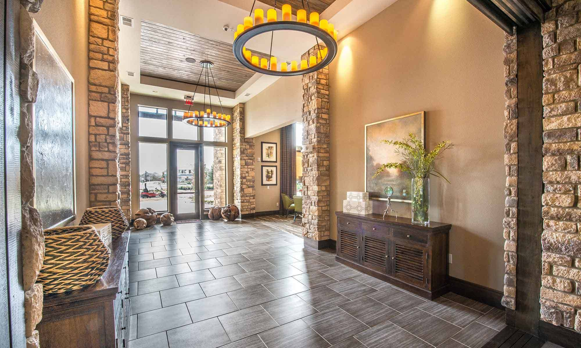 Interior view of the beautifully decorated leasing center at The Abbey at Spring Town Center