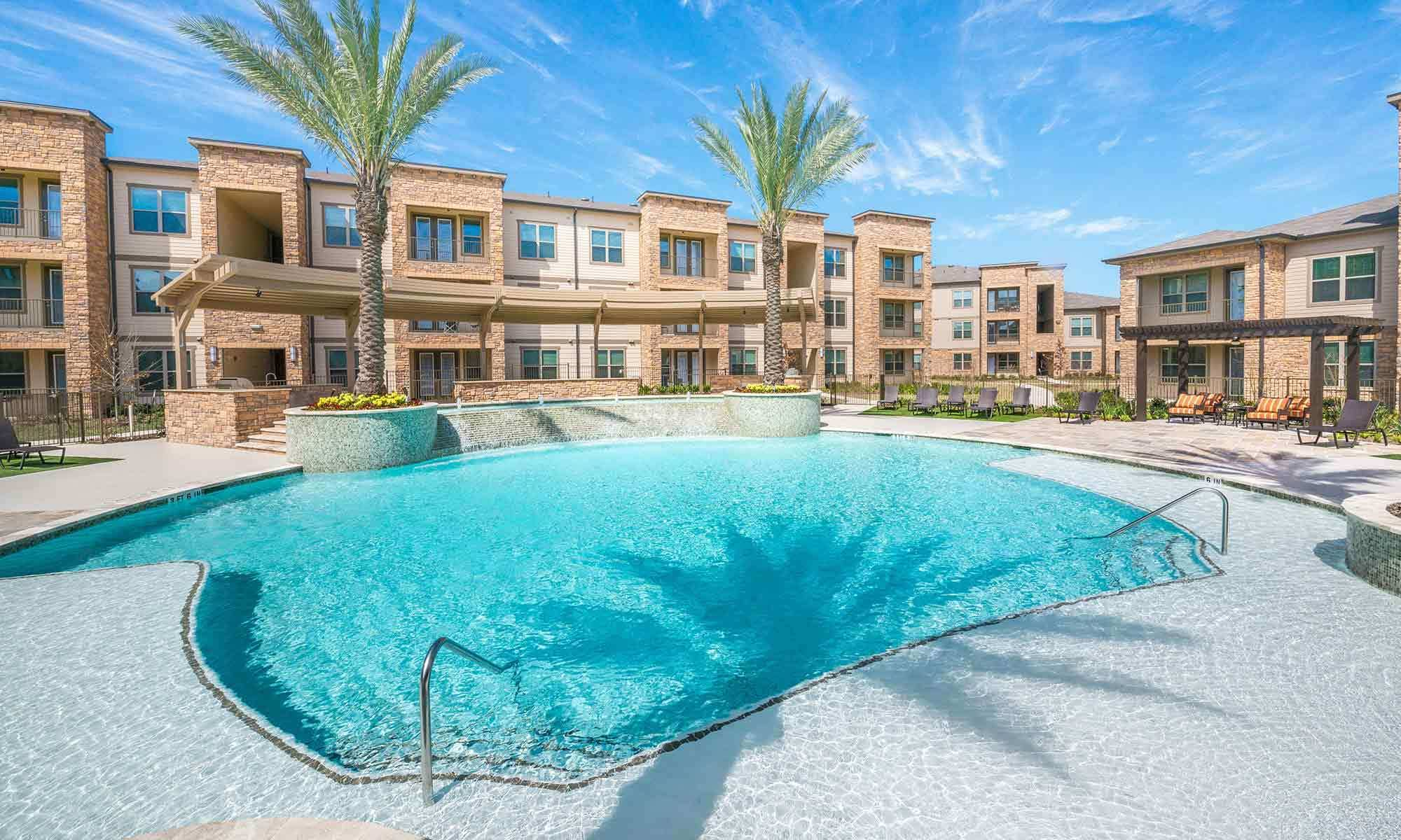 Beautiful view of the sparkling swimming pool at The Abbey at Spring Town Center