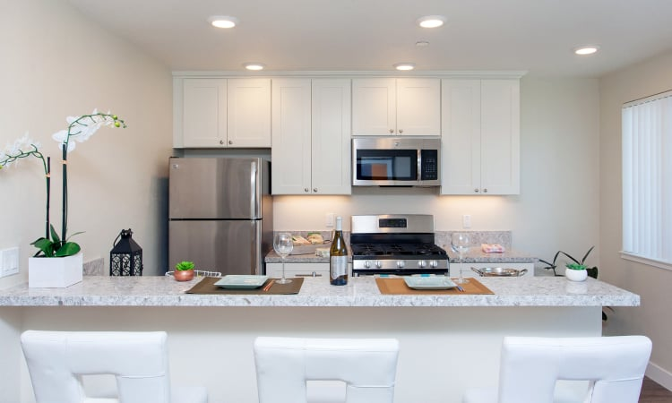 Bright, modern kitchen with granite countertops in model home at The Arlington in Burlingame, CA
