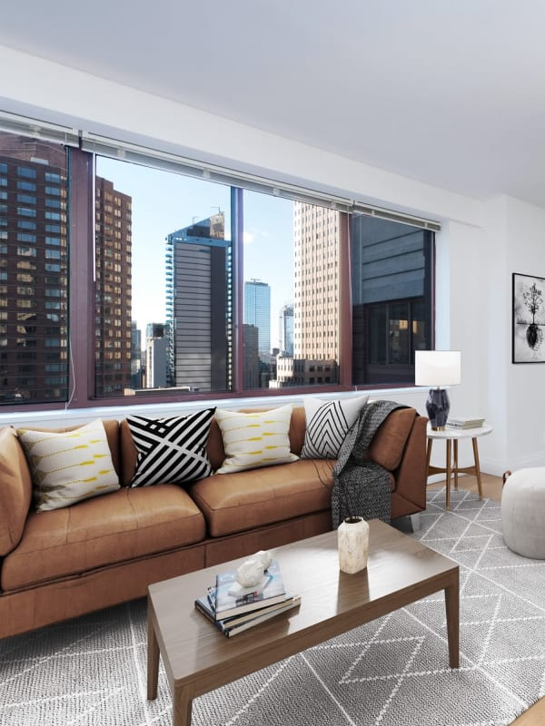 Living room with a beautiful city view at The Ellington in New York, New York