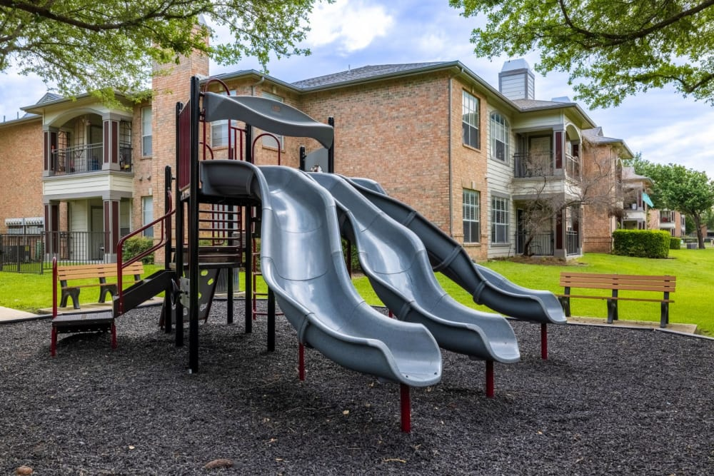 Park with a slide at Brooks on Preston in Plano, Texas