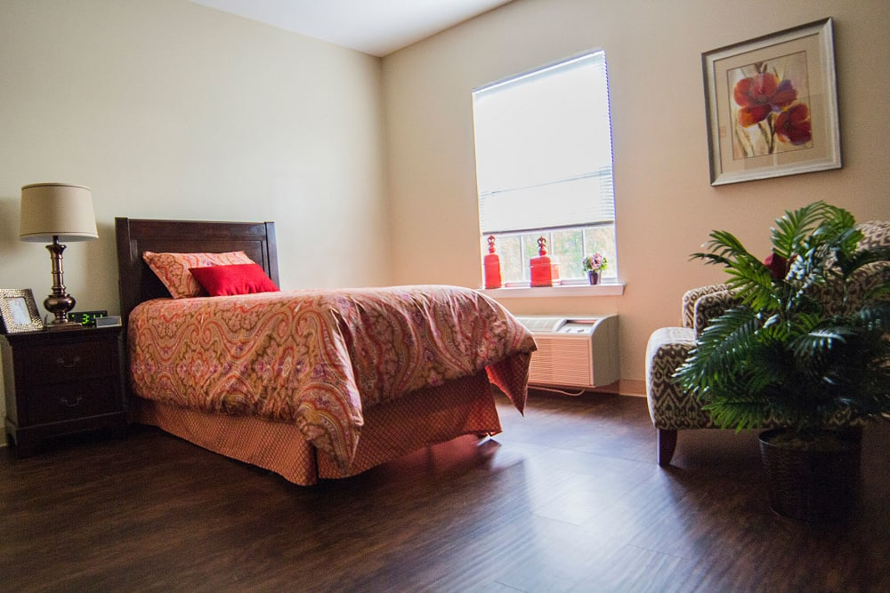 Wood flooring in an apartment bedroom at The Village at Bellevue in Nashville, Tennessee