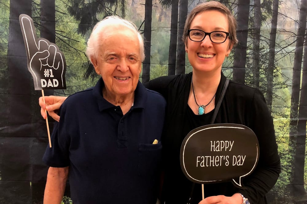 Resident and his daughter enjoying a community celebration together