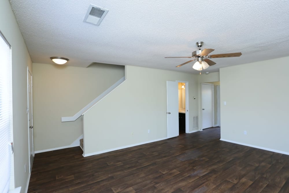 Spacious living room with stairs at Madison Pines in Madison, Alabama
