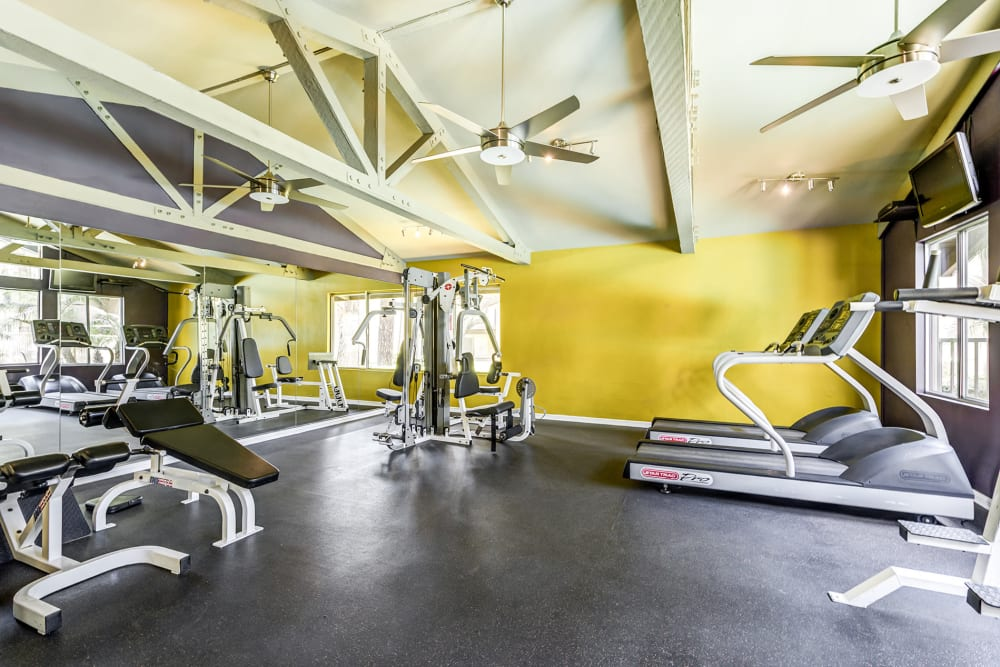 Fitness center with a variety of equipment at Olive Ridge in Pomona, California