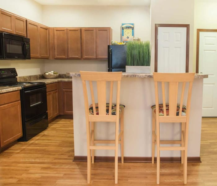 Apartment kitchen with island seating at Tradition Pointe in Ankeny, Iowa